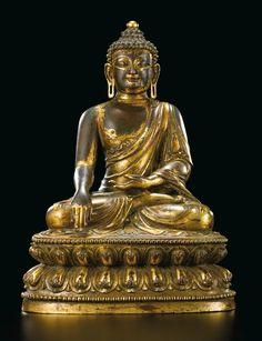 A GILT BRONZE FIGURE OF SHAKYAMUNI BUDDHA  INCISED MARK AND PERIOD OF YONGLE