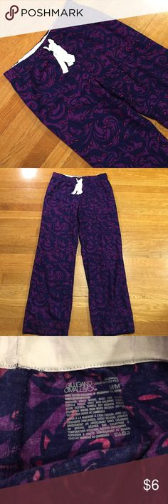 Gilligan & O'Malley purple sleepwear pajamas pants These are a pair of soft comfortable pajama bottoms by Gilligan & O'Malley, purple and pink pattern, elastic and tie waist band. Has one pocket and back. See pictures for details. Good condition minor wear. Be sure to check out other items in closet and bundle to receive discounts. Gilligan & O'Malley Intimates & Sleepwear Pajamas