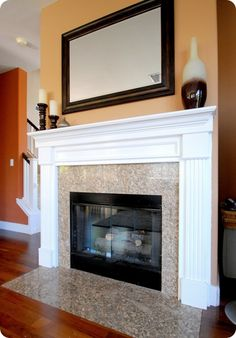 Check out the before/after pics of this oak mantel makeover. I'm doing this!