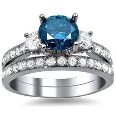 <li>Blue and white engagement bridal ring set</li><li>18k white gold jewelry</li><li><a href='http://www.overstock.com/downloads/pdf/2010_RingSizing.pdf'><span class='links'>Click here for ring sizing guide</span></a></li>