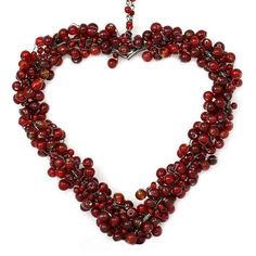 Red Glass Beaded Heart Ornaments.Size: Length - 6 Inches, Width - 6 InchesWeight - 0.16 Kg.Set of 2 Heart Ornaments.Handmade in India.This item can be shipped to Europe locations only.