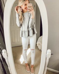 Peplum // peplum top // long sleeved top // Spring accessories // earrings // floral earrings // Spring shoes // slip on shoes // slides // pink shoes // Spring outfit // Spring outfits // outfit ideas // blonde hair // blonde hairstyles // white jeans // distressed jeans