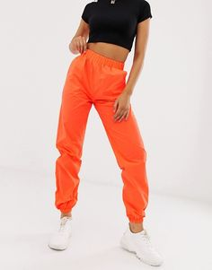 Buy Missguided reflective cargo trousers in orange at ASOS. Get the latest trends with ASOS now. Orange Outfits, Orange Pants Outfit, Cargo Pants Outfit, Neon Outfits, Cargo Pants Women, Colourful Outfits, Pants For Women, Fashion Outfits, Orange Clothes