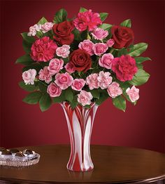 Teleflora's Swirls of Love - Make a big, beautiful impression this Valentine's Day with this breathtaking bouquet of red and pink roses.