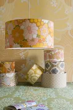 A great use of old wallpaper!  Wallpaper covered lampshades.