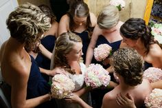 A great picture of bridesmaids praying for bride at her wedding. I want a picture like this at my wedding!