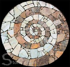 Mosaic Stone Art.  Love the use of contrasting stones.