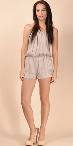 This semi sheer romper features a tonal dobby stripe with gathered drawstring detail and key hole tie closure at back neck. Elastic gathers at waist. Curved side pockets. Fully lined. 100% polyesterDry clean only