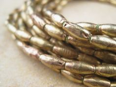 Hey, I found this really awesome Etsy listing at https://www.etsy.com/listing/215101524/elongated-brass-oval-beads-from-the