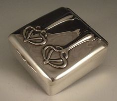 Manufacturer 	Connell & Sons, Designer	Unknown, Silver cigarette box, England, 1905  http://www.titusomega.com/Object%20Profile%20and%20Photos/Old%20profiles/Metalware/Connell_silver_box.htm