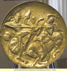 Elam: The Parthians and Black Sassanians Gold  plate depicting a Sassanian king  spearing a Roman