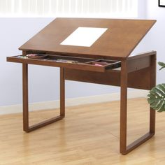 Ponderosa Wooden Drafting Table by Studio Designs - warm wood and simple lines make this drawing table functional and aesthetically pleasing. Lots of storage organizes your pastels, charcoal or other drawing materials.