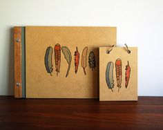 feathers, journals, wood. three things i love.