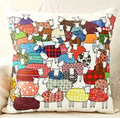 Large cushion showing colourful flock of sheep illustrated by Mary Kilvert. This cushion will brighten up any room