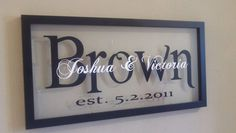 name sign. Purchased a double pane frame from Hobby Lobby and put black vinyl lettering for the last name and the first names in white vinyl