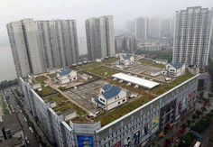 Would you buy a house built on top of a shopping mall________?  You can do it in Zhuzhou, ‪#‎China‬, the second largest city in the Hunan province ‪#‎travel‬ ‪#‎mall‬ ‪#‎building‬ #architect