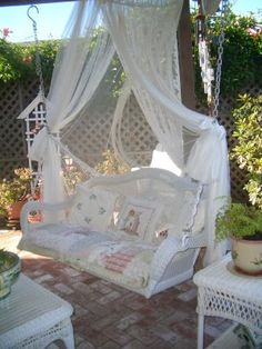 I sssooooo must have a porch swing.  WITH BUG CURTAIN. Patio Swing, via Flickr.