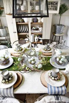 Springy Moss & Egg Easter Table Springy Easter table – Great spring & easter tablescape ideas perfect for a farmhouse or cottage style dining room. Easter wreaths, easter eggs, easter centerpiece, & more ideas! Easter Table Settings, Easter Table Decorations, Decoration Table, Easter Centerpiece, Centerpiece Ideas, Thanksgiving Decorations, Easter Dinner, Easter Brunch, Easter Party