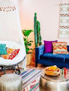 Colorful bohemian living room   shop the look: blue velvet sofa...