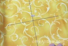 Centering your fabric when it's too small or too bulky to hoop. WeAllSew « http://weallsew.com