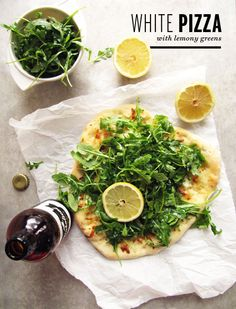 White Pizza with Lemony Greens.  Homemade dough topped with garlic olive oil, provolone, mozzarella, parmesan, and goat cheese and finished with arugula (or spinach) dressed with a lemon vinaigrette. Delish!