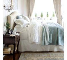 Silk Channel Two-Toned Quilt & Sham   Pottery Barn  love the white cream and blue together