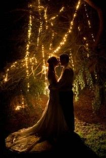 A magical wedding photo, great idea to have twinkle lights as a drop against the night sky and the bride and groom as silohuettes