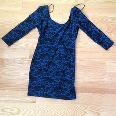 Bodycon blue mini dress long sleeved this dress has stretchy and comfortable material and has NEVER been worn!! The floral pattern is very unique and cute!! The back of the dress swoops low also. Forever 21 Dresses Mini