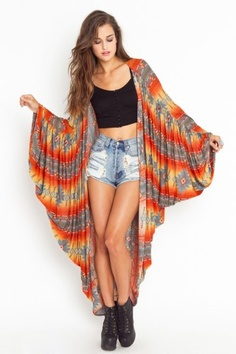 Navajo Drape Cardi $88.00 Ultra-drapey long cardi featuring dolman sleeves and a navajo print in shades of orange, gold, teal, tan, and ivory. Open front, unlined. Looks awesome tossed over a tank and cutoffs!