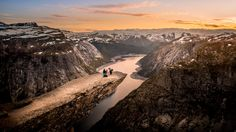So I did one shot called Trolltunga Romantic previously and it so happened I felt the irresistible urge to improve it. If a shot doesn't make me happy I'll try something new and here it is - the new one. This couple absolutely warmed my heart, it was a beautiful surprise to me to be witnessing this.    Unfortunately this dangerous beauty, Trolltunga, had its first victim. On Saturday evening a young woman fell and lost her life. I suggest having a quiet moment for her.
