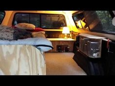 Silverado camper - single bed with aisle, solar panel attachment on roof, power inverter for 3 scooter batteries