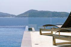 Enjoy the incredible view of the infinity pool and the Andaman Sea beyond from Villa Benyasiri, Samsara Villas Phuket.