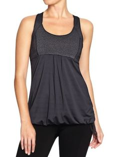 Compression Tank: This tank has nice thick straps for comfort and security. It's also got a draped overlay so you won't feel like your tummy is exposed.