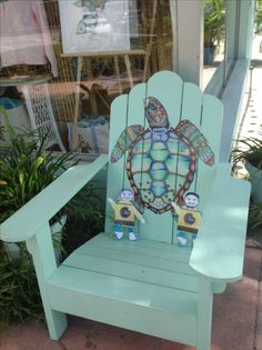 Enjoying a rest in the custom painted adirondack chairs by artist Nora Butler