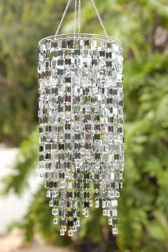 Shimmer Falls Wind Chime - Silver The stunning looks of our Exhart Shimmer Falls Light Reflector Wind Chimes will delight you and your guests. A cascade of shimmering materials hides the wind chimes at the center of this exquisite w. Cd Diy, Carillons Diy, Sell Diy, Recycled Cds, Recycling, Diy Wind Chimes, Glass Wind Chimes, Ideias Diy, Suncatchers