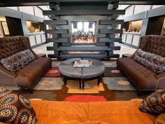 The Sebastian, Vail, Colo.  A relative newcomer to Vail's celebrity scene, this luxury boutique resort opened in late 2010 with a modern take on Rocky Mountain lodge style. The lobby's centerpiece is this cozy conversation area, with a sculptural stacked-wood fireplace, warm colors and high-backed tufted sofas. Image courtesy of…
