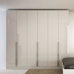 Add extra storage space with the Manhattan Comfort 'Downtown' wardrobe. This contemporary wardrobe interior features three top shelves, two bottom shelves, four cubbies, four drawers and three Wardrobe Design Bedroom, Bedroom Bed Design, Bedroom Wardrobe, Wardrobe Closet, Modern Wardrobe, Bedroom Cupboard Designs, Bedroom Cupboards, Bedroom Cupboard Doors, Cabinet Doors