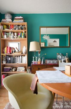 Paint colors that match this Apartment Therapy photo: SW 7505 Manor House, SW 6062 Rugged Brown, SW 6124 Cardboard, SW 6762 Poseidon, SW 7672 Knitting Needles