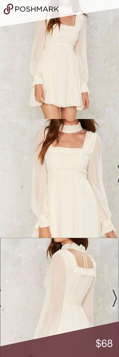 Nasty Gal Rosamund Babydoll Dress Doll it up. The Rosamund Dress is made in ivory chiffon and features a thin lace panel at front, fit & flare silhouette, mini length, crochet and ruffle detailing, snaps at sleeves, and enclosed zipper at back. Fully lined. By Nasty Gal. Nasty Gal Dresses Mini