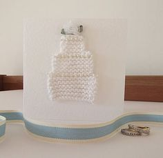DIY hand-knitted wedding invites? I can have my sister do this for free ;D