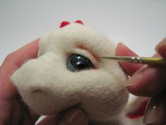 how to make the cutest little needlefelted dragon whelp - in Russian but with good pictures