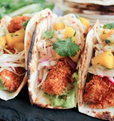 Crispy Fish Tacos with Mango Salsa and Avocado Salsa Verde. Light, fresh and perfect for all your warm weather fiestas. (This fish is baked not fried!)