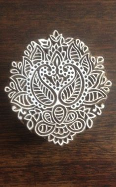 paisley string block to stamp fabric or rugs. glue string onto a peice of card with a pattern drawn on it. apply fabric paint with a sponge and use it to stamp fabric.iron to fix the pattern
