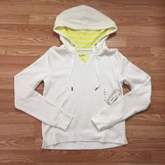 Pull Over Hoodie NWT White Pull Over Hoodie with Bright Yellow Stripes inside the hood. Tops Sweatshirts & Hoodies