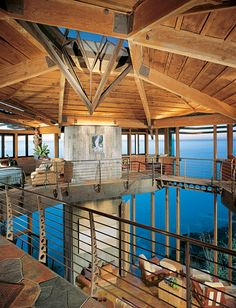 Tall ceilings and a loft area at Partington Point Cliffhouse originally designed by Richard Clements and remodelled by Mickey Muennig, known as the Big Sur architect