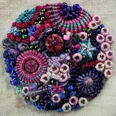 Embroidered Button ~ inspiration only: had forgotten the lushness of whipped spider stitch.  Very cool!