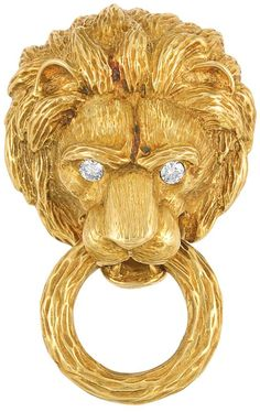 Gold and Diamond Lion Head Clip-Brooch, Van Cleef & Arpels 18 kt., the sculptural textured gold lion's head accented by 2 round diamond eyes approximately .20 ct., grasping a ring in its mouth, signed...