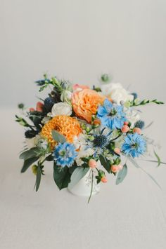 orange and blue Wedding Inspiration - Style Me Pretty