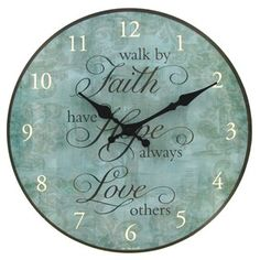 """Accent decor with this Turquoise Faith, Hope, Love Round Wall Clock.    Made to hang on a wall, the MDFclock measures 12"""" in diameter and requires one AA battery (not included).    Full text: walk by Faith; have Hope always; Love others"""