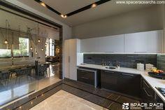 Waterfall House, Sanctum Sanctorum, Dark Color Palette, Stone Cladding, Space Race, Open Kitchen, Ground Floor, Double Vanity, Modern